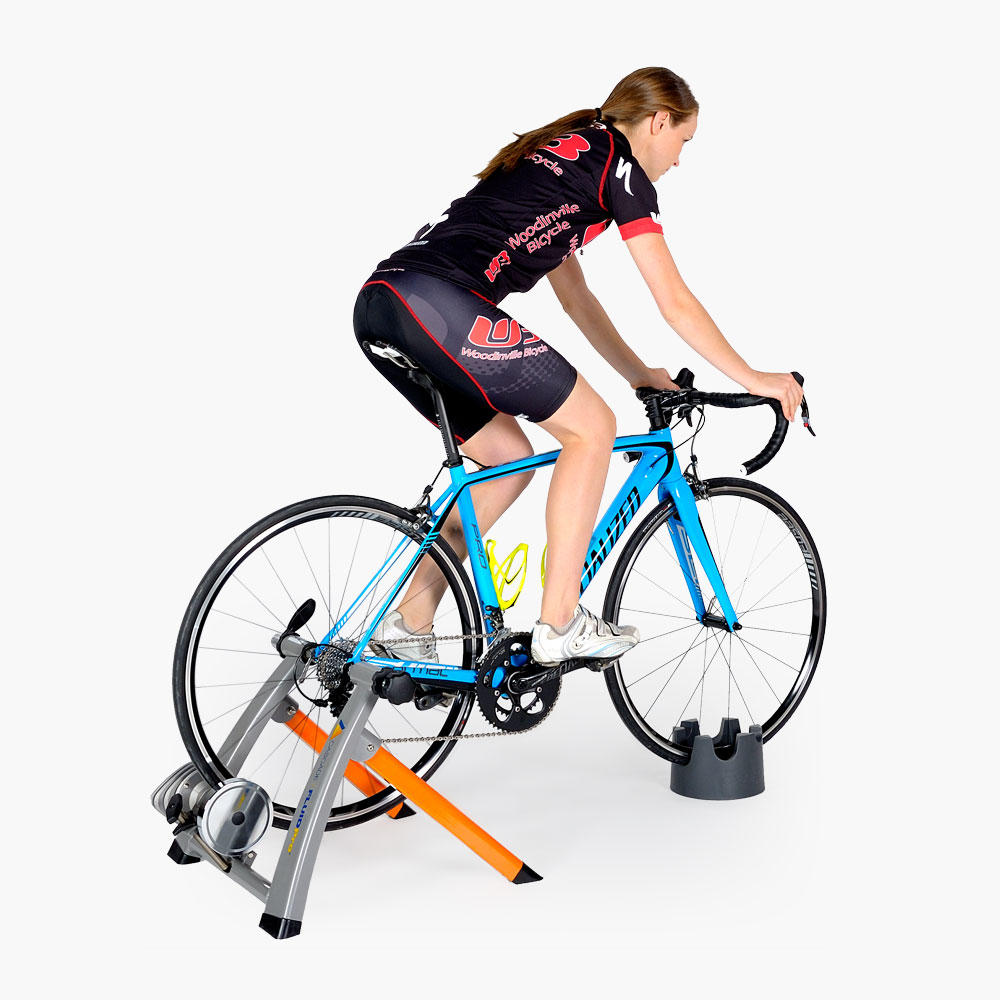 Cascade FluidPro Indoor Bike Trainer with Girl